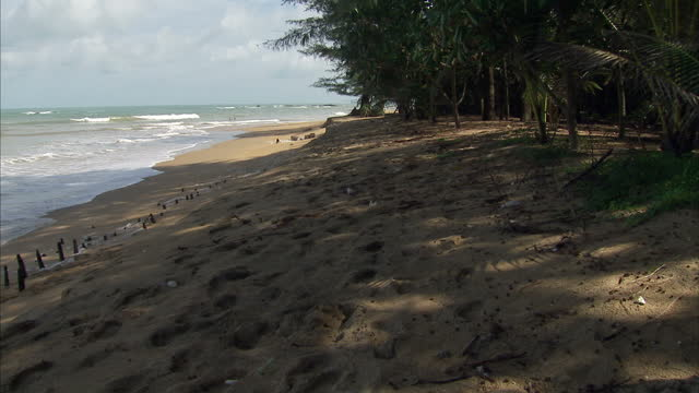 exterior shots of khao lak beach and small waves crashing on surrounding rocks on august 29 2014 in khao lak thailand - 2004 indian ocean earthquake and tsunami stock videos & royalty-free footage