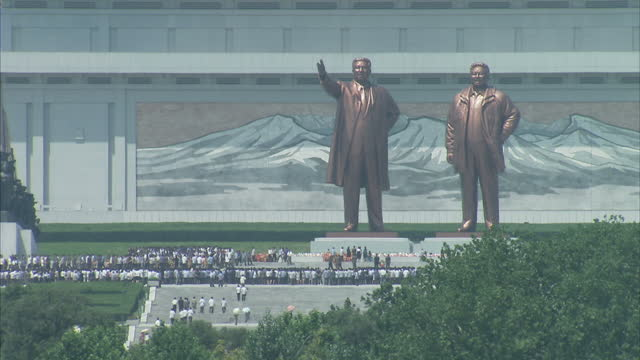Exterior shots of Kim Il Sung statue in Mansudae the unfinished Ryugyong Hotel in the skyline the Monument to the Foundation of the Workers Party of...