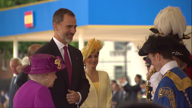 Exterior shots of King Felipe and Queen Letizia of Spain greeting officials with Queen Elizabeth and Prince Philip Duke of Edinburgh during a...