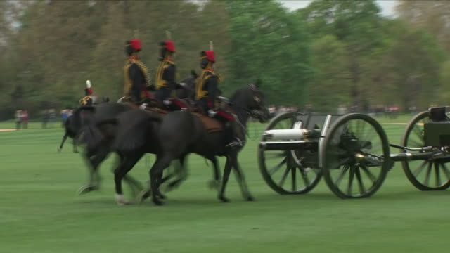 Exterior shots of King's Troop Royal Horse Artillery riding in Hyde Park and taking away the guns after ceremonial gun salute on 24 April 2018 in...