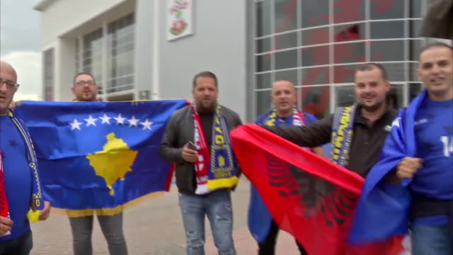 exterior shots of kosovo football fans outside st mary's stadium ahead of their uefa euro 2020 qualifier against england on 10th september 2019 in... - コソボ点の映像素材/bロール