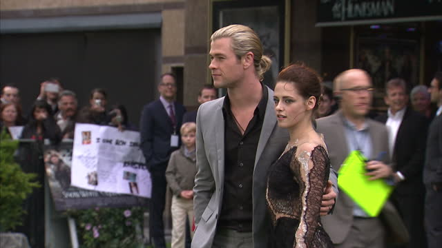 exterior shots of kristin stewart chris hemsworth on the red carpet at the world premiere of 'snow white and the huntsman' at empire leicester square... - empire stock videos & royalty-free footage
