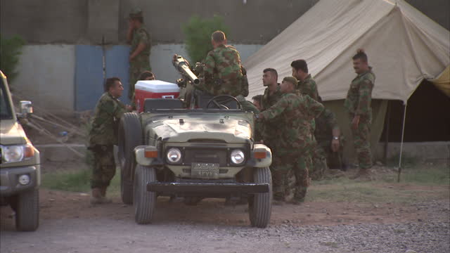 exterior shots of kurdish regional government armed military troops at a base with armed military trucks in khanaqin on june 18 2014 in kurdistan iraq - isil konflikt stock-videos und b-roll-filmmaterial