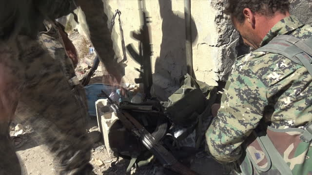 Exterior shots of Kurdish YPG soldiers with guns dancing and celebrating after the fall of Raqqa on 17 October 2017 in Raqqa Syria