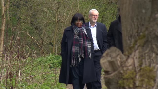 exterior shots of labour leader jeremy corbyn and shadow home secretary diane abbott with halifax mp holly lynch walking onto activity centre grounds... - diane abbott stock videos & royalty-free footage