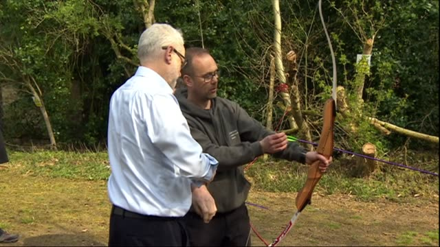 stockvideo's en b-roll-footage met exterior shots of labour leader jeremy corbyn mp trying his hand at archery whilst visiting a youth activity centre on 15 april 2019 in hipperholme... - labor partij