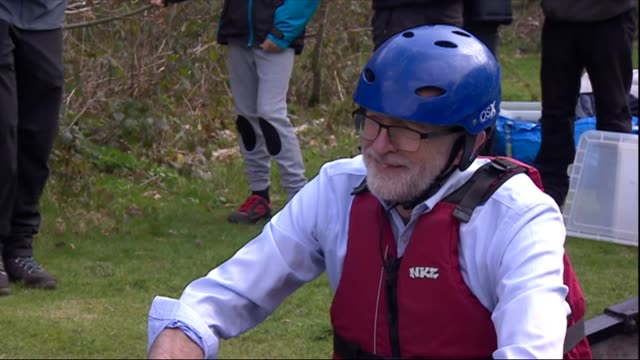 exterior shots of labour leader jeremy corbyn mp visiting a youth activity centre talking to organisers and sitting in a canoe on land on 15 april... - jeremy corbyn stock-videos und b-roll-filmmaterial