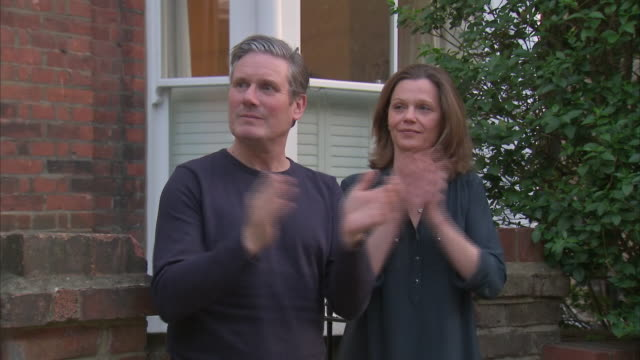 exterior shots of labour leader sir keir starmer and wife victoria starmer clapping in support of the nhs on 23 april 2020 in london, united kingdom. - keir starmer stock videos & royalty-free footage