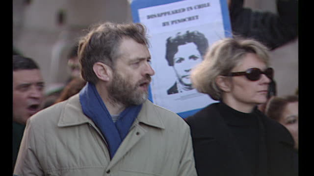 exterior shots of labour mp for islington north jeremy corbyn walking with a large group of people at an anti pinochet protest 'march for justice' on... - archives stock videos & royalty-free footage