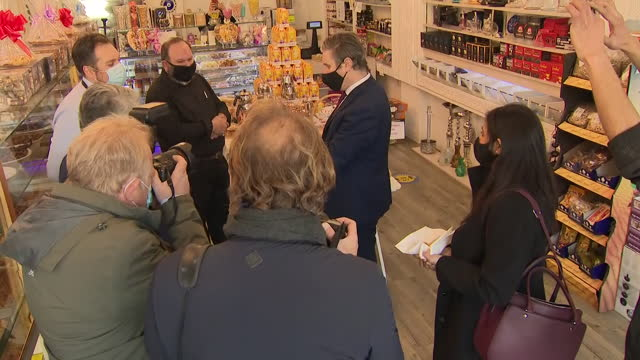 exterior shots of labour party leader sir keir starmer visiting shops along the kingsbury high street and speaking to shop owners on 22nd march 2021... - high street stock-videos und b-roll-filmmaterial
