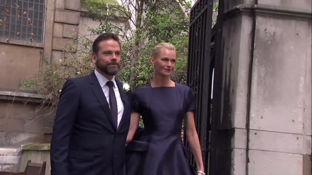 exterior shots of lachlan murdoch wife sarah murdoch walk out of church garden to pose for photo op for press st brides church for the wedding of... - rupert murdoch stock videos and b-roll footage