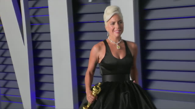 Exterior shots of Lady Gaga winner for Best Original Song on the red carpet of the 2019 Vanity Fair Oscar Party posing with Academy Award on 24th...