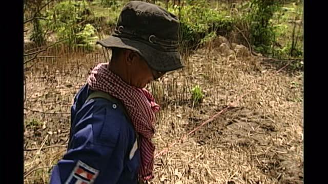 exterior shots of land mine clearance taking place with men using metal detectors to search for landmines on april 27th 1998 in phnom penh cambodia - land mine stock videos and b-roll footage