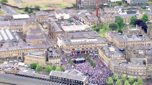exterior shots of large crowds in the centre of huddersfield town and the football team on a makeshift stage celebrating the team's promotion to the... - huddersfield town football club stock videos & royalty-free footage
