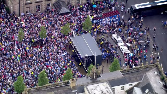 exterior shots of large crowds in the centre of huddersfield town and the football team on a makeshift stage celebrating the team's promotion to the... - major league soccer stock videos and b-roll footage
