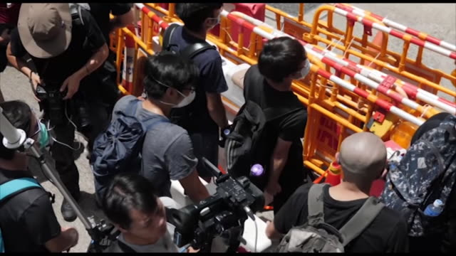exterior shots of large crowds of chanting young protesters in masks and holding umbrellas in streets outside the police headquarters on 21 june 2019... - chanting stock videos and b-roll footage