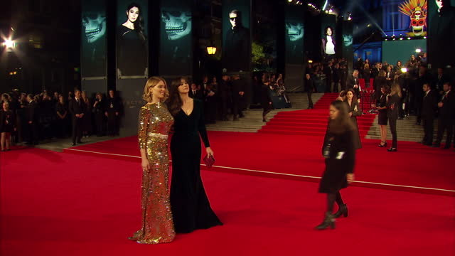 Exterior shots of Lea Seydoux and Monica Bellucci posing for photo op on the red carpet at the Royal World Premiere of 'Spectre' at Royal Albert Hall...