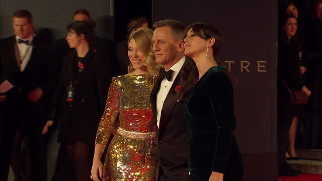 Exterior shots of Lea Seydoux Daniel Craig and Monica Bellucci posing for photo op on the red carpet at the Royal World Premiere of 'Spectre' at...