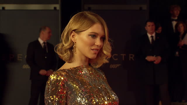 exterior shots of lea seydoux posing for photo op on the red carpet at the royal world premiere of 'spectre' at royal albert hall on october 27 2015... - spectre 2015 film stock videos and b-roll footage