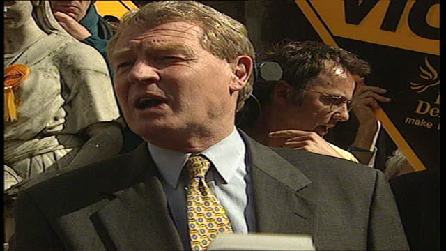 Exterior shots of Leader of the Liberal Democrats Paddy Ashdown arriving by coach in Bath to a crowd of supporters and making a speech on his...