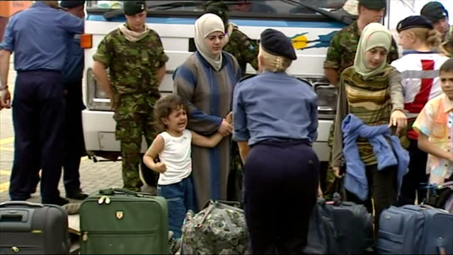 exterior shots of lebanese mothers and children boarding hms bulwark moored in the port of beirut during the 2006 conflict between israel and... - 2006 stock videos & royalty-free footage