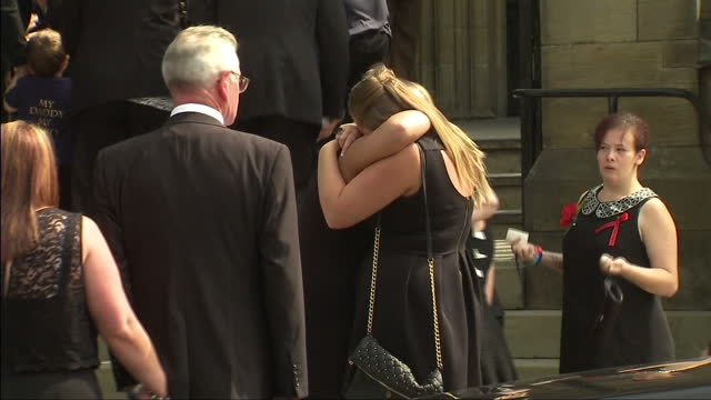 exterior shots of lee rigby's family getting out of the funeral car outside the church re grouping and hugging and walking inside lee rigby's family... - lee rigby stock videos & royalty-free footage