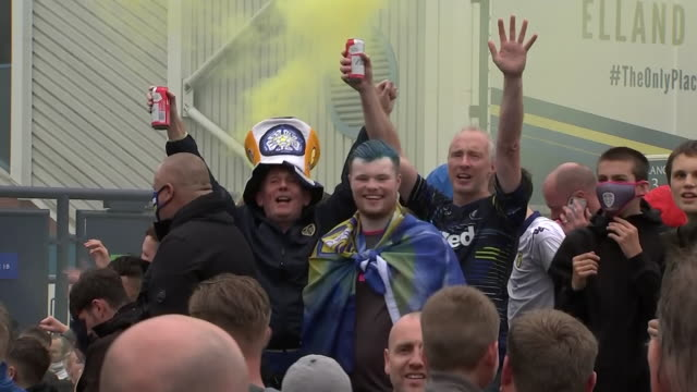 exterior shots of leeds fans celebrating promotion to the premier league outside elland road. - celebration stock videos & royalty-free footage