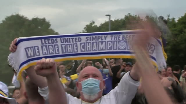 exterior shots of leeds fans wearing face masks while celebrating promotion outside elland road. - leeds stock videos & royalty-free footage