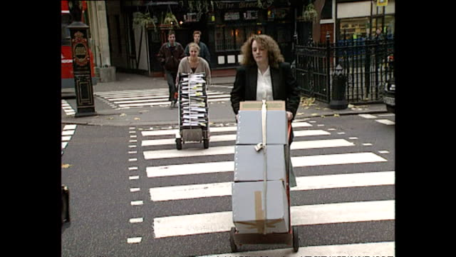 exterior shots of legal teams arriving with lots of boxes of paperwork for the case of panayiotou v sony music entertainment ltd at the royal courts... - sony stock-videos und b-roll-filmmaterial