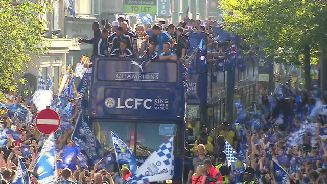 exterior shots of leicester city football club players celebrate winning the english premier league on buses as they parade down streets surrounded... - leicester stock videos & royalty-free footage