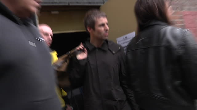 exterior shots of liam gallagher walking along canal and refusing to speak to the media on 30 may 2017 in manchester united kingdom - bombing stock videos & royalty-free footage
