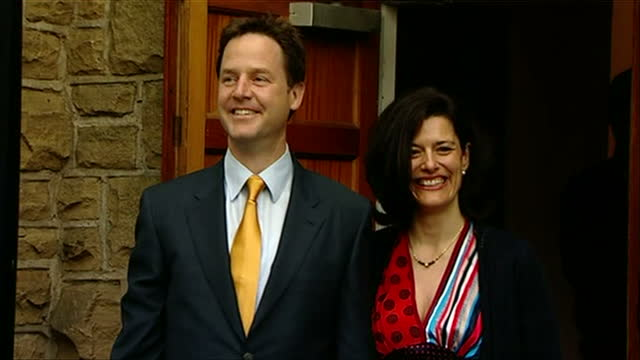Exterior shots of Lib Dem leader Nick Clegg and wife Miriam entering and leaving a polling station in Sheffield to vote and waving to crowds on May...