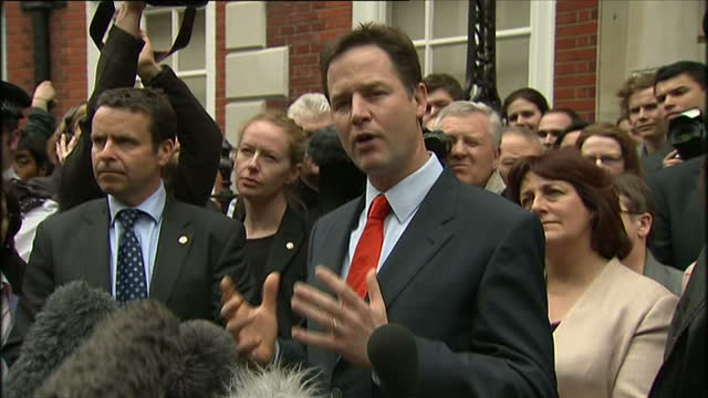 exterior shots of liberal democrat leader nick clegg making a statement to crowds outside liberal democrat hq on the day after the 2010 general... - british liberal democratic party stock videos & royalty-free footage