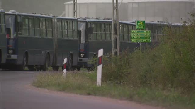 exterior shots of lines of buses parked on the hungarian side of the hungary croatian border on september 19, 2015 in beremend, hungary. - ungarn stock-videos und b-roll-filmmaterial
