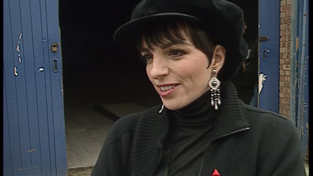 Exterior shots of Liza Minelli being interviewed outside rehearsal studios Elton John arriving by car and being greeted by Liza Minnelli and Liza...