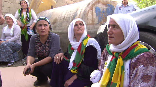 exterior shots of local kurdish people gathered in the centre of silopi after recent clashes between kurds and turkish police forces on july 29 2015... - silopi stock videos and b-roll footage