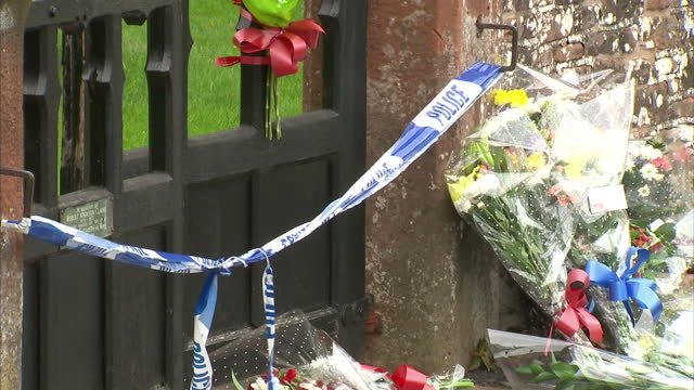 exterior shots of local people viewing and laying floral tributes to murdered teenager jordan watson outside the cordoned off cemetery where his body... - seilabsperrung stock-videos und b-roll-filmmaterial