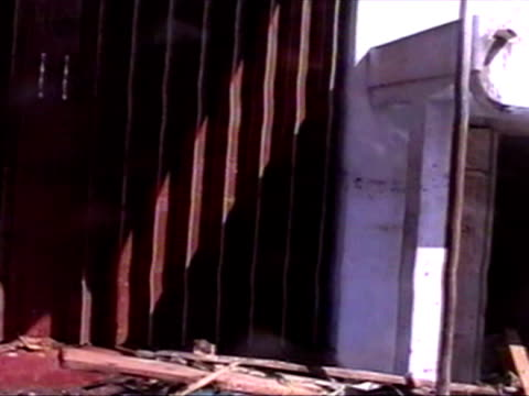 exterior shots of local residents walking through flooded streets with families crying upset and angry at what has happened boxing day tsunami... - 2004年点の映像素材/bロール