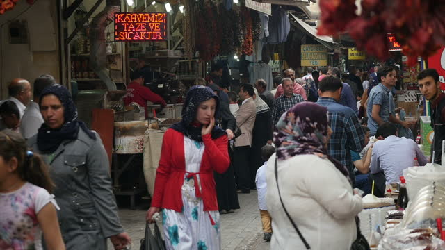 Exterior shots of locals and shoppers going about Market Bazaar and looking at various products on sale on May 02 2016 in ��anl��urfa Turkey