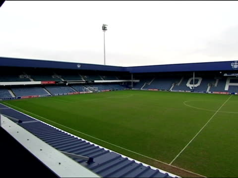 Exterior shots of Loftus Road QPR Football Stadium pan around seating in stands and goals on pitch QPR Loftus Road Stadium on January 15 2009 in...