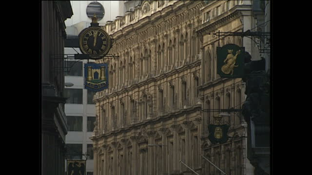 Exterior shots of Lombard Street with a TSB and gold cat fiddle logo and Lloyds bank exteriors and a close up shot of the Lloyds bank black horse...