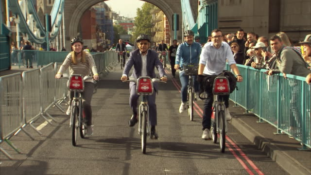 exterior shots of london mayor of london sadiq khan arrivig on a bicycle and conduct interviews to celebrate world car free day in london on 22nd... - sadiq khan stock videos & royalty-free footage