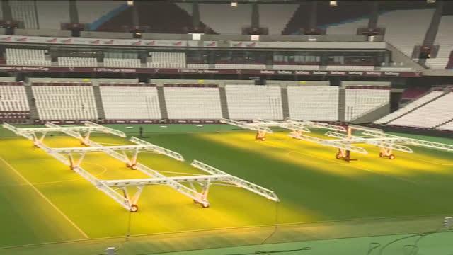 exterior shots of london stadium, people sweeping, general pans at olympic stadium on november 01, 2016 in london, england. - グランドキーパー点の映像素材/bロール