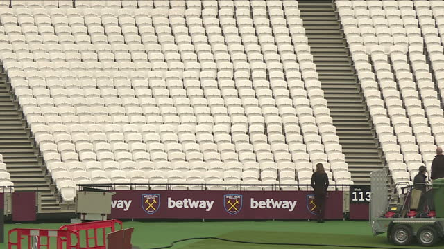 exterior shots of london stadium seats and shots of people walking through the empty stadium. olympic stadium on november 01, 2016 in london, england. - physical activity stock videos & royalty-free footage