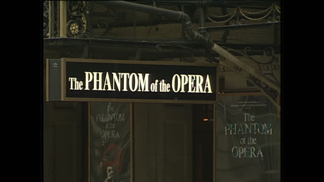 "stockvideo's en b-roll-footage met exterior shots of london west end theatres, including london palladium theatre, her majesty's theatre & ""phantom of the opera"" posters, the garrick... - 1980 1989"
