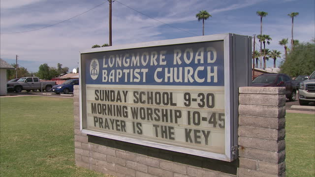 exterior shots of longmore road baptist church with parishoners walking out after a sunday service on 4 november 2016 in mesa arizona united states - religious service stock videos and b-roll footage