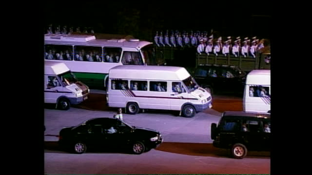 exterior shots of lorries and buses full of chinese pla soldiers crossing the border from china into hong kong during the british handover ceremony... - ceremony stock videos and b-roll footage