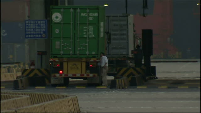 exterior shots of lorries and shipping containers at shanghai deep water container port on october 21, 2008 in shanghai, china. - film container stock videos & royalty-free footage