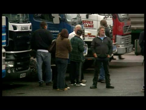 exterior shots of lorry drivers, fuel protest. shows lorry drivers standing around. - ガス料金点の映像素材/bロール