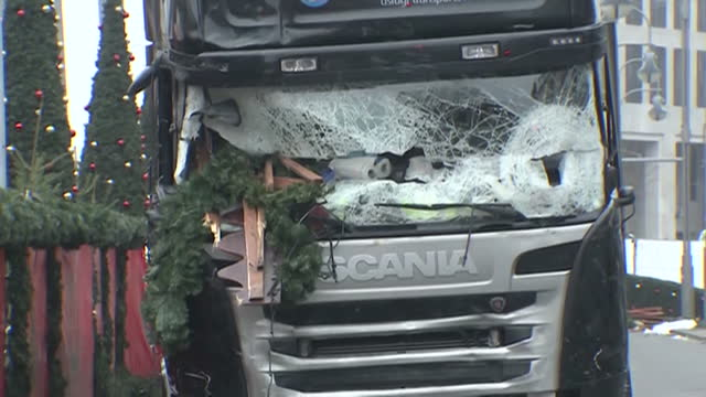 Exterior shots of lorry that was used in Christmas market attack with smashed windscreen and Christmas tree toppled over onto street on December 20...